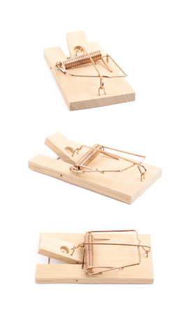 Wooden mousetrap device isolated over the white background , set of several different foreshortenings