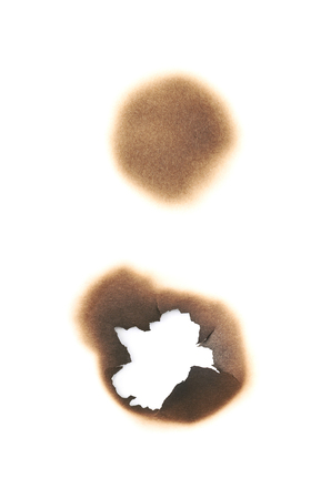 Round paper burn mark stained hole isolated over the white background , set of several different foreshortenings Banco de Imagens
