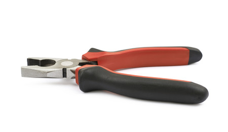 Black and red pliers tool isolated over the white background Stock Photo
