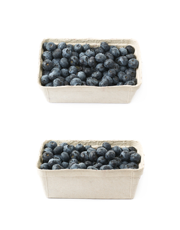 Box full of ripe blueberries isolated over the white background , set of several different foreshortenings