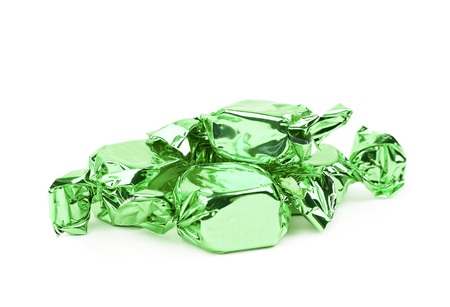 Wrapped candies isolated over the white background