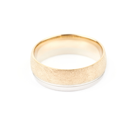 Golden wedding band ring isolated over the white background