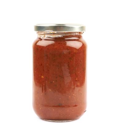 Jar of marinara tomato sauce isolated over the white background