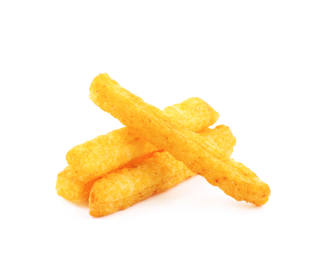 Pile of flavoured puffed cornmeal stick snacks isolated over the white background