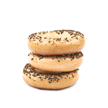 Poppy seeds bagel composition isolated over the white background