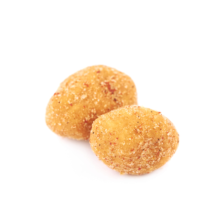 Pile of breadcrumb coated spiced nuts isolated over the white background Stock Photo