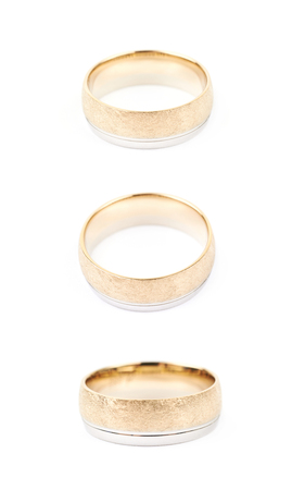 Golden wedding band ring isolated over the white background, set of three different foreshortenings