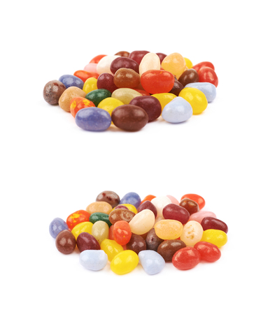 Pile of jelly bean candies isolated over the white background, set of two different foreshortenings 스톡 콘텐츠
