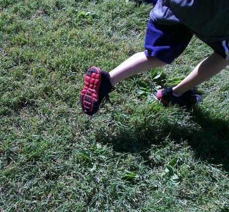 Child Running on Grass photo