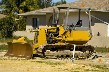 job site: A little bulldozer sits at the edge of a job site Stock Photo