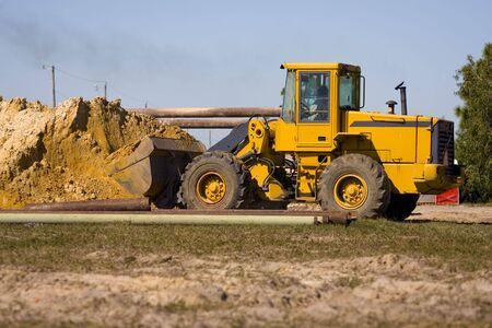 front end: A front end loader with a full shovel