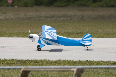 A Piper Cub tail dragger RC model airplane taxiing for take off