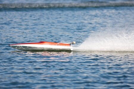 rc: An RC model boat doing practice laps