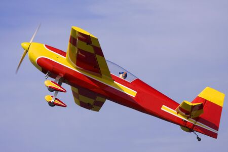 A model airplane pulls out of a steep dive