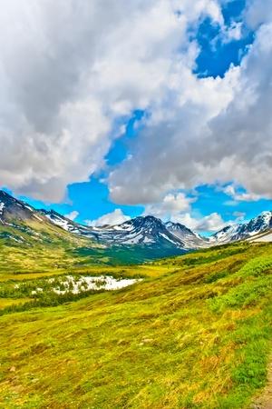 Clouds covering an Alaskan valley. Фото со стока