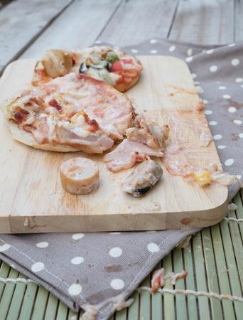 sloppy: pizza sloppy by children hand Stock Photo