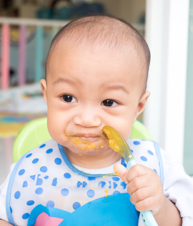 eating baby with spoon
