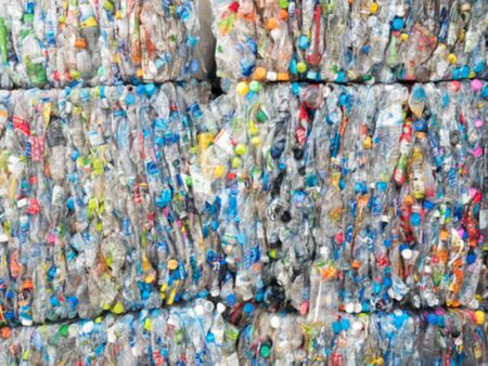 thermoplastic: out of focus large stack of old plastic bottles Stock Photo