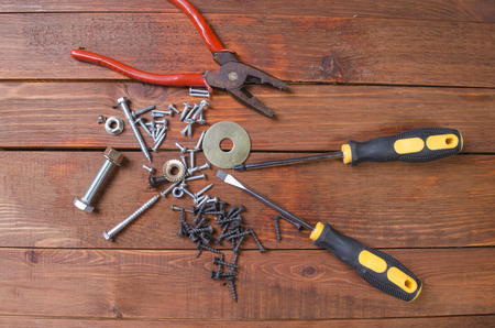 it is a lot of tools for repair of the house on a wooden background