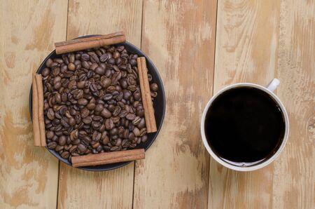 seasonings: coffee with grains and fragrant seasonings on a table