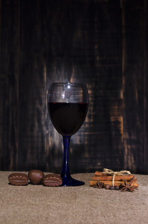sacking: wine in a glass glass on a sacking with chocolate Stock Photo
