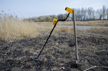 entertaining area: metal the detector with a shovel outdoors Stock Photo