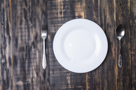 ware: white ware and tableware on a wooden board Stock Photo