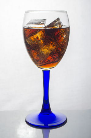 aerated: cool drink in a glass glass on a white background