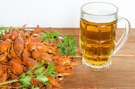 boiled crayfish with parsley on a wooden table
