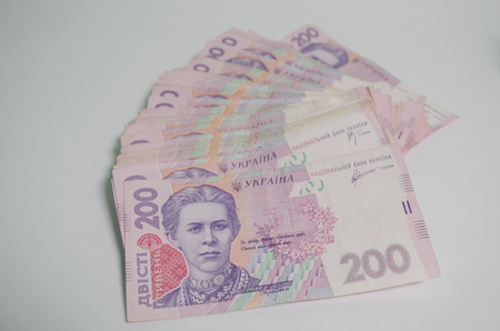 invents: the banknote of the Ukrainian currency on a white table is a lot of