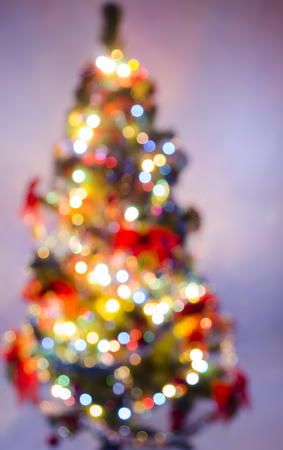newer: blurred background of a New Year tree which is washed away on a card