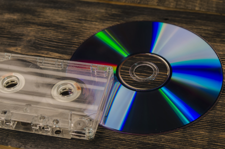 music on the old magnetic cartridge on a wooden table Stock Photo
