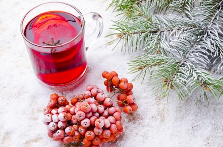 seasonings: cup of hot mulled wine with seasonings on a table