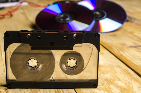 80th: the magnetic cartridge for the tape recorder on a wooden table