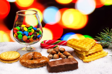 also cookies on snow are a lot of multi-colored chocolates Stock Photo