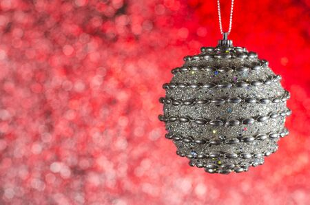 silver ornament for the Christmas tree on the color Stock Photo