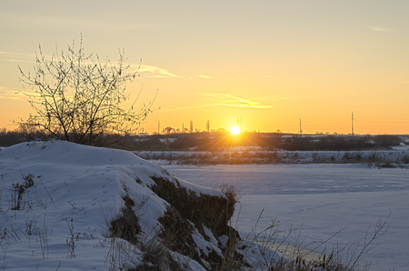 covered fields: sunrise on a cold and snowy winter day Stock Photo