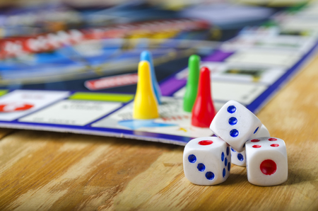 Cubes with the board game on the table Foto de archivo