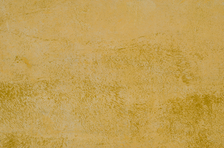 background from an old metallic yellow surface with paint