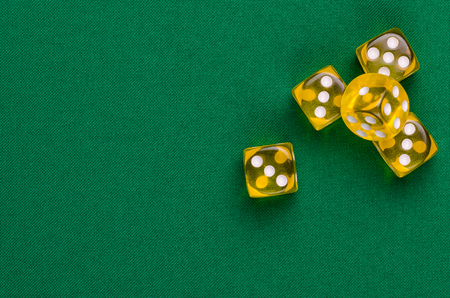 several yellow cubes lie on a green table Banco de Imagens