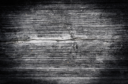 vintage black white wooden background with cracked paint