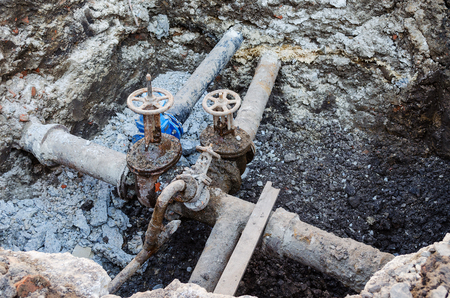carrying out repair of the pipeline in the city Banco de Imagens