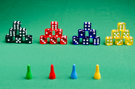 houses from playing cubes with chips on a green background Banco de Imagens