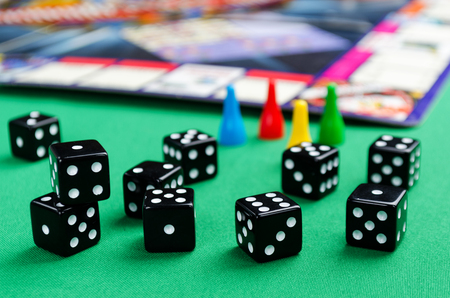 black dice for board games on a green background