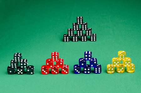 many color game cubes on a green background