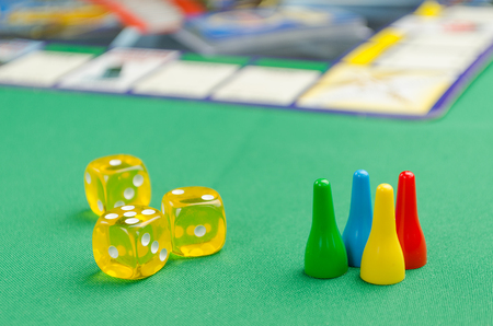 yellow game dice for board game on a green background Banco de Imagens