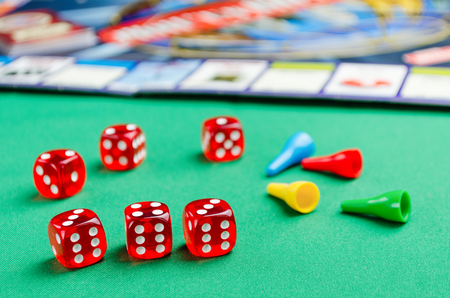 several red dice for board games on a green background