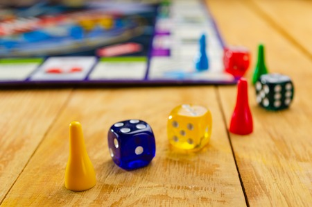 board game with cubes on a wooden background