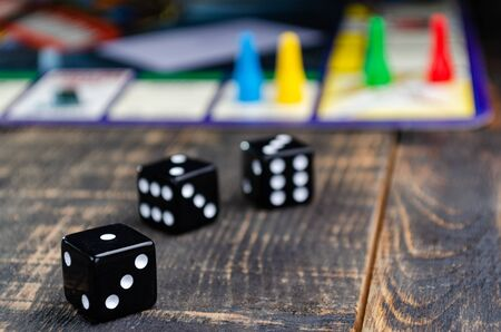 three black dice for a board game on the board Stockfoto