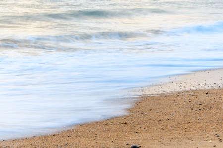 Sandy beach along the Atlantic coast in a summer evening. Stock fotó
